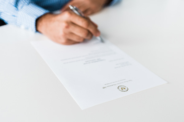 Picture of document being signed